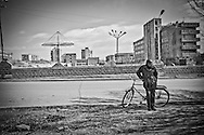 Man and his bicycle near Metsamor City, home to the only nuclear power plant in Caucasus. Metsamor. 2005.
