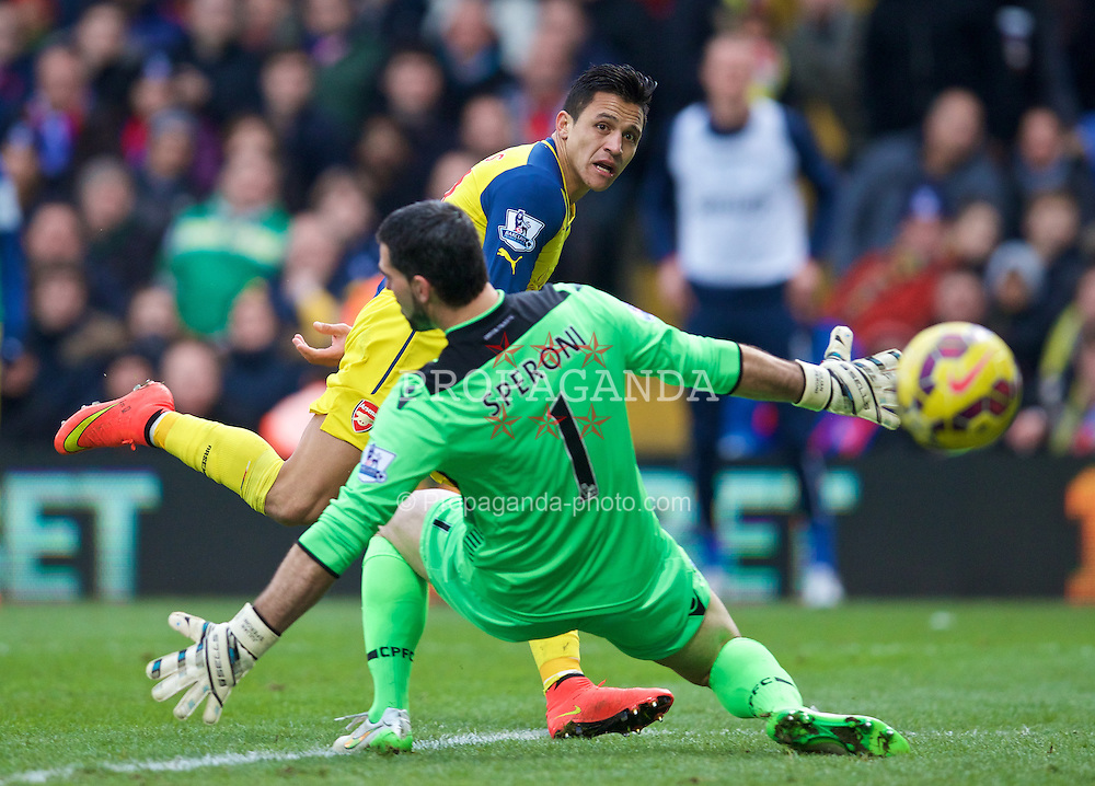 LONDON, ENGLAND - Saturday, February 21, 2015: Arsenal's Alexis Sanchez sees his shot go past Crystal Palace's goalkeeper Julian Speroni and wide of the goal during the Premier League match at Selhurst Park. (Pic by David Rawcliffe/Propaganda)