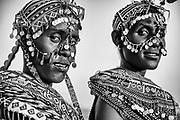 A portrait in black and white of two Samburu girls decorated with beaded headdresses and colorful beaded necklaces, Lake Turkana, Loiyangalani,Kenya, Africa