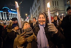 """10 December 2017, Oslo, Norway: In the evening of 10 December some 4,000 people from around the world gathered in central Oslo for a torch light march for peace. The event took place after the Nobel Peace Prize award 2017, awarded to the International Campaign to Abolish Nuclear Weapons (ICAN), for """"its work to draw attention to the catastrophic humanitarian consequences of any use of nuclear weapons and for its ground-breaking efforts to achieve a treaty-based prohibition of such weapons"""". Among the crowd were more than 20 """"Hibakusha"""", survivors of the atomic bombings in Hiroshima and Nagasaki, as well as a range of activists, faith-based organizations and others who work or support work for peace, in one or another way. Here, Anne Grete (left) and Kari (right), who have been active in """"No to Atomic Bombs"""" in Norway, one of the partners in ICAN, for more than 40 years."""