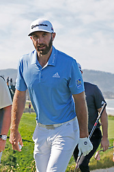 June 11, 2019 - Pebble Beach, CA, U.S. - PEBBLE BEACH, CA - JUNE 11: PGA golfer Dustin Johnson walks to the 10th tee during a practice round for the 2019 US Open on June 11, 2019, at Pebble Beach Golf Links in Pebble Beach, CA. (Photo by Brian Spurlock/Icon Sportswire) (Credit Image: © Brian Spurlock/Icon SMI via ZUMA Press)