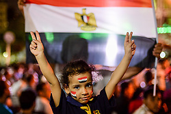 CAIRO, Oct. 9, 2017  An Egyptian girl celebrates after a 2018 FIFA World Cup qualification match between Egypt and Congo, in Cairo, Egypt, on Oct. 8, 2017. Egypt won 2-1 on Sunday and secured its place in the FIFA World Cup finals in Russia. (Credit Image: © Str/Xinhua via ZUMA Wire)