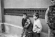 Children looking and a man in military clothes at the Varazdin refugee camp in Croatia in the winter of 1992.