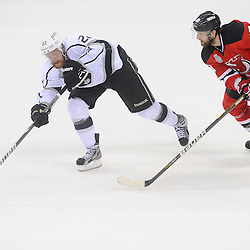 June 9, 2012: Los Angeles Kings center Trevor Lewis (22) passes the puck away from Los Angeles Kings right wing Kevin Westgarth (19) during third period action in game 5 of the NHL Stanley Cup Final between the New Jersey Devils and the Los Angeles Kings at the Prudential Center in Newark, N.J. The Devils defeated the Kings 2-1.