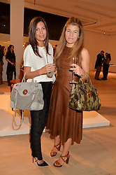 Left to right, AMANDA SHEPPARD and AMBER NUTTALL at an evening of Fashion, Art & design hosted by Ralph Lauren and Phillips at the new Phillips Gallery, 50 Berkeley Square, London on 22nd October 2014.