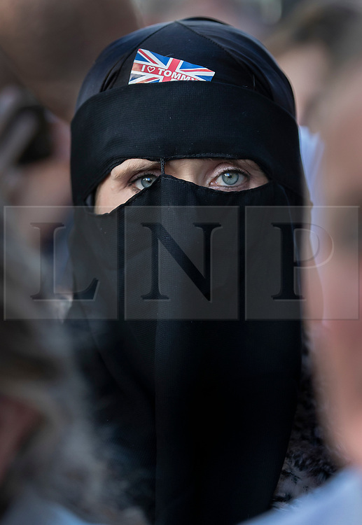 © Licensed to London News Pictures . 27/09/2018. London, UK. A woman wearing a full face veil with an 'I Love Tommy' sticker waits to catch sight of former EDL leader Tommy Robinson after he left the Old Bailey , where his retrial for Contempt of Court was adjourned - following his actions outside Leeds Crown Court in May 2018 . Robinson was already serving a suspended sentence for the same offence when convicted in May and served time in jail as a consequence , but the newer conviction was quashed by the Court of Appeal and a retrial ordered . Photo credit: Peter Macdiarmid/LNP