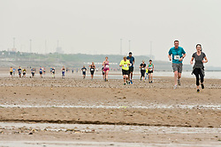 Runners gathered for the annual Portobello Beach Run this morning across the sands of Portobello Beach. Starting and finishing at the Promenade bar, The Dalriada, the runners went to the far end of the beach at Seafield and back again, splashing through the Figgate Burn twice on their way.<br /> © Jon Davey/ EEm