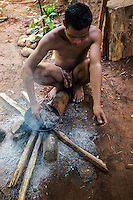 Palawano tribesman stoking a fire to dry out cotton.  The Palawano, Palawan or the Pala'wan tribe are an indigenous ethnic group on the island of Palawan.  The Palawano typically keep to themselves in their mountain hideouts and rarely speak Tagalog much less English.