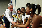 """Chicago Mayor Rahm Emanuel (L) greets family members of the first graduating class of Christ the King Jesuit College Preparatory School prior to a commencement ceremony on Saturday, June 9th 2012. Emanuel applauded the 50 students for beating the odds, adding in his address that """"They had every excuse available for why they couldnÕt graduate or go to college. But instead of settling for otherÕs peopleÕs easy excuses, they set their own high expectations. Their accomplishment this weekend stands as a rebuke to anyone who adopts a cynical attitude about what the students of Chicago, even in the roughest neighborhoods, can accomplish"""".  Brian J. Morowczynski~ViaPhotos..For use in a single edition of Catholic New World Publications, Archdiocese of Chicago. Further use and/or distribution may be negotiated separately. ..Contact ViaPhotos at 708-602-0449 or email brian@viaphotos.com."""