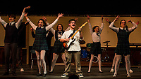 """Dewey Finn"" Jonathan Buttrick convinces his students to play in a rock band during dress rehearsal for School of Rock at Gilford High School Tuesday evening.  (Karen Bobotas/for the Laconia Daily Sun)"