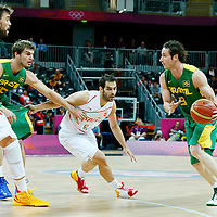 06 August 2012: Brazil Marcelinho Huertas drives past Spain Jose Calderon during 88-82 Team Brazil victory over Team Spain, during the men's basketball preliminary, at the Basketball Arena, in London, Great Britain.