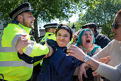 © Licensed to London News Pictures. 15/05/2018. London, UK. Police and protestors clash in Whitehall ahead of the arrival of Turkish President Recep Tayyip Erdogan to Downing Street. President Erdogan will meet with British Prime Minister Theresa May later. Photo credit: Rob Pinney/LNP