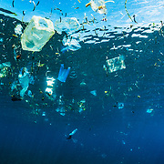 Plastic garbage floats at the surface of the Pacific ocean during a tide change off Indonesia.