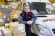 Financial Times commission for Business Life section, Working Lives.<br /> James Valentine, delivery driver for DPD pictured at their depot in Wimborne, Dorset.<br /> BL11.<br /> Picture date: Tuesday December 8, 2015.<br /> Photograph by Christopher Ison ©<br /> 07544044177<br /> chris@christopherison.com<br /> www.christopherison.com