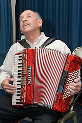 Man playing accordion and singing,