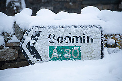 © Licensed to London News Pictures Ltd.  01/02/2019. A road sign for Bodmin on the A30, covered in snow. Rescue crews help stranded motorists on the A30 on Bodmin Moor, who were stranded last night by heavy snowfall. Most motorists were put the up on camp beds in the nearby Jamaica Inn. Photo credit: Mark Hemsworth/LNP