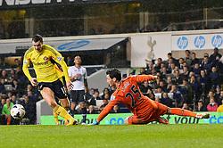 Sunderland's midfielder Adam Johnson and Tottenham's goalkeeper Hugo Lloris compete for the ball  - Photo mandatory by-line: Mitchell Gunn/JMP - Tel: Mobile: 07966 386802 07/04/2014 - SPORT - FOOTBALL - White Hart Lane - London - Tottenham Hotspur v Sunderland - Premier League