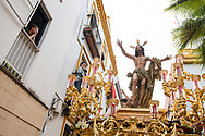 The float with the resurrected Christ salutes the people of Seville watching from their windows. Sevilla is the only city where a procession leaves on Easter day, la Resurrección (The Resurrection) founded in 1969 sale (gets out) in the street in white costume with a more joyful attitude. Andalusia, Spain