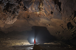 """An expedition member works within the Miao Room Chamber, China's largest cave chamber by volume, in Ziyun County of southwest China's Guizhou Province, April 14, 2016. In 2014, National Geographic announced Miao Room Chamber, with a volume of some 19.78 million cubic meters, as the world's largest cave chamber. A joint caving expedition code-named """"Pearl"""" by explorers and scientists from China and France kicked off here on April 11 during the 19-day exploration, they will conduct comprehensive investigation on famous caves in Guizhou including the Miao Room Chamber and Shuanghe Cave in Suiyang. EXPA Pictures © 2016, PhotoCredit: EXPA/ Photoshot/ Ou Dongqu<br /> <br /> *****ATTENTION - for AUT, SLO, CRO, SRB, BIH, MAZ, SUI only*****"""