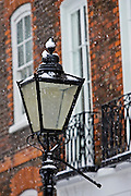 Snow covered street lamp in Hampstead, North London, England, United Kingdom