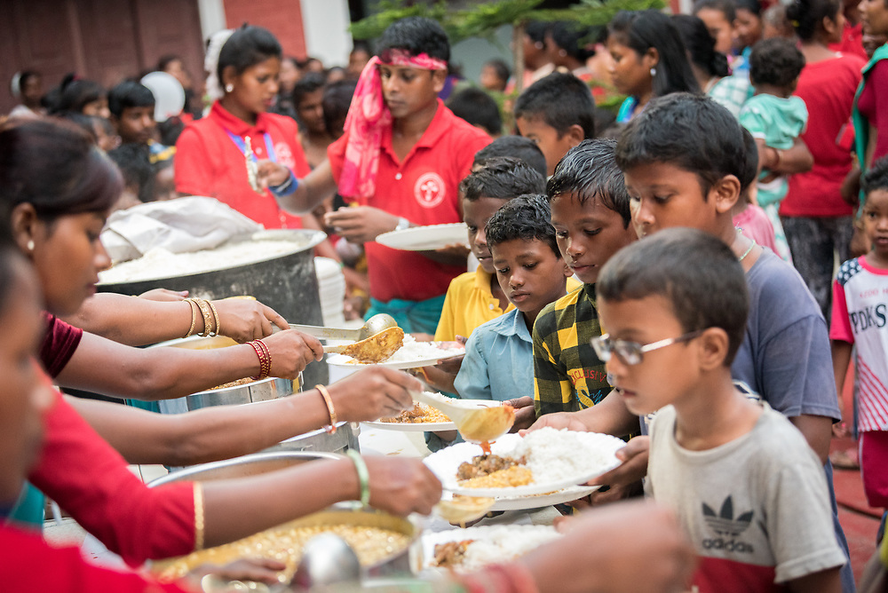 14 September 2018, Laxmipur, Nepal: Food is served after the service, as more than 800 congregants, guests and dignitaries celebrate the 75th anniversary of the Nepal Evangelical Lutheran Church, a member of the Lutheran World Federation.