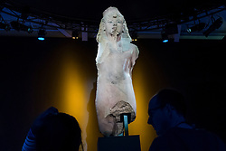 """© Licensed to London News Pictures. 01/11/2019. LONDON, UK. """"Colossal Quartzite Statue of Tutankhamun, Usurped by Ay and Horemheb"""". Preview of """"Tutankhamun, Treasures of the Golden Pharoah"""" at the Saatchi Gallery in Chelsea.  The exhibition celebrates the 100th year anniversary of the opening of Tutankhamun's tomb and displays 150 works in the largest collection of Tutankhamun's treasures ever to leave Egypt.  The show runs 2 November to 3 May 2020.  Photo credit: Stephen Chung/LNP"""