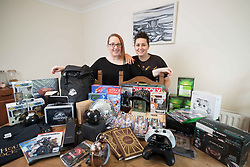 Faye Bradley and Marina Murphy at home in Ennis , Co Clare Ireland with some of the 180 prizes they have won so far. Photograph by Eamon Ward