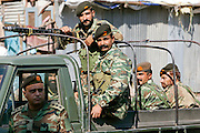 Armed Pakistani soldiers in open top vehicle with machine gun in village of Pattika, Pakistan