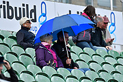 Spectators in the Somerset Stand put their umbrellas up as the rain starts to fall during the Specsavers County Champ Div 1 match between Somerset County Cricket Club and Lancashire County Cricket Club at the Cooper Associates County Ground, Taunton, United Kingdom on 14 September 2017. Photo by Graham Hunt.