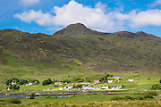 Traditional Scottish village nestled by the shoreline at Kilchoan on the Ardnamurchan Peninsula in Western Highlands of Scotland the most western point of UK mainland