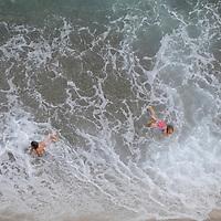Arial view of people having fun play in the sea in Monaco.