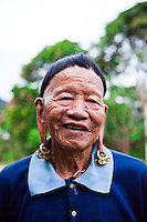 The Kelabit has retained his traditional styled hair and long ears.