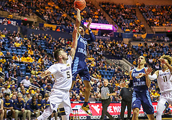 Dec 1, 2019; Morgantown, WV, USA; Rhode Island Rams guard Fatts Russell (1) shoots over West Virginia Mountaineers guard Jordan McCabe (5) during the first half at WVU Coliseum. Mandatory Credit: Ben Queen-USA TODAY Sports