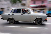 Two guys in driving a Lada automobile, photographed  with motion blur technique.