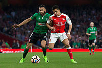 Lincoln City's Nathan Arnold battles for possession with Arsenal's Alexis Sanchez      <br /> <br /> <br /> Photographer Craig Mercer/CameraSport<br /> <br /> The Emirates FA Cup Sixth Round - Arsenal v Lincoln City - Saturday 11th March 2017 - The Emirates - London<br />  <br /> World Copyright © 2017 CameraSport. All rights reserved. 43 Linden Ave. Countesthorpe. Leicester. England. LE8 5PG - Tel: +44 (0) 116 277 4147 - admin@camerasport.com - www.camerasport.com