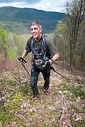 Aaron Sorenson, 39, San Francisco, CA climbs the testical spectacle on loop 1 of the Barkley Marathons.