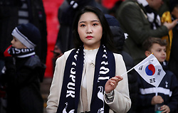 A Tottenham Hotspur fan in the stand shows her support