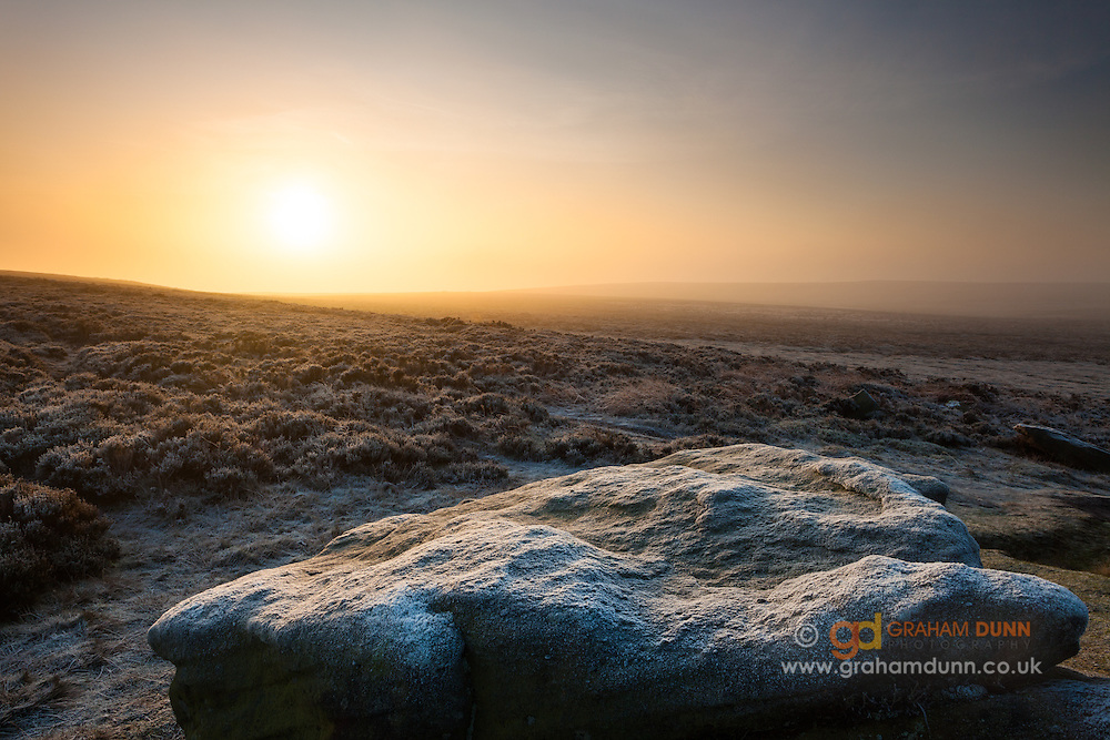 Dawn mist and a heavy frost over the Ox Stones at Burbage Moor, Peak District.