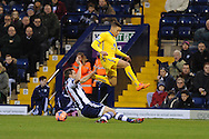 Dwight Gayle of Crystal Palace is tackled by West Brom's Gareth McAuley. FA Cup with Budweiser, 3rd round, West Bromwich Albion v Crystal Palace match at the Hawthorns in Birmingham, England on Saturday 4th Jan 2014.<br /> pic by Andrew Orchard, Andrew Orchard sports photography.
