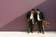 """Mercedes, TX - 26 Mar 2008 <br /> Mariachis crack a joke while waiting to perform """"La Negra"""" on Wednesday morning at an opening ceremony for phase 2 of the Rio Grande Valley Outlets in Mercedes."""