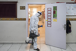 Staff members disinfect Yesilkoy Armenian School, in Istanbul, Turkey, on March 15, 2020. Turkey confirmed 6 cases of novel coronavirus infection in the country. Photo by Akin Celiktas/Depo Photos/ABACAPRESS.COM