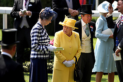 Her Majesty The Queen (centre) and Anne, Princess Royal (left) in the parade ring during day two of Royal Ascot at Ascot Racecourse.