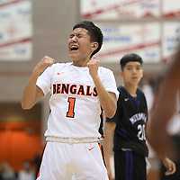 Gallup Bengal Quentin Richards (1) reacts to missing a free throw during their 1-4A semi-final tournament game against the Miyamura Patriots Wednesday night at Gallup High School. Gallup took the win 72-39.