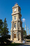 The Ottoman style clock tower of the  Dolmabahçe (Dolmabahce)  Palace, built by Sultan, Abdülmecid I between 1843 and 1856. Istanbul Turkey .<br /> <br /> If you prefer to buy from our ALAMY PHOTO LIBRARY  Collection visit : https://www.alamy.com/portfolio/paul-williams-funkystock/istanbul.html<br /> <br /> Visit our TURKEY PHOTO COLLECTIONS for more photos to download or buy as wall art prints https://funkystock.photoshelter.com/gallery-collection/3f-Pictures-of-Turkey-Turkey-Photos-Images-Fotos/C0000U.hJWkZxAbg