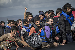 Oct. 13, 2015 - Lesbos Island, Greece - Refugees and Migrants arrive on the Greek Island of Lesbos after crossing the Aegean sea from Turkey on October 12, 2015  (Credit Image: © Antonio Masiello/NurPhoto via ZUMA Press)