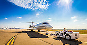 Bombardier Global Express being towed on the ramp at Kalamazoo International Airport, Michigan.  <br /> <br /> Created by aviation photographer John Slemp of Aerographs Aviation Photography. Clients include Goodyear Aviation Tires, Phillips 66 Aviation Fuels, Smithsonian Air & Space magazine, and The Lindbergh Foundation.  Specialising in high end commercial aviation photography and the supply of aviation stock photography for advertising, corporate, and editorial use.