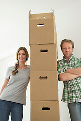 Portrait couple new home room moving in