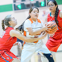 Gallup Bengal Justine Tso (3), center, is surrounded by Valencia Jaguars on a drive during the Wingate Holiday Classic girls basketball tournament championship game at Wingate High School Saturday.