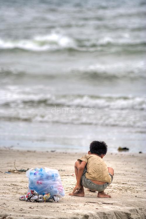 Boy stands on beach, Sihanoukville, Cambodia
