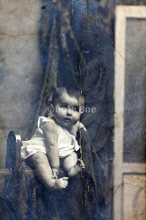 surface cracked studio style baby vintage portrait